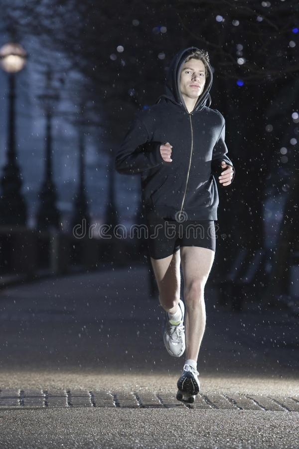 Male Runner On Early Winter Morning stock photos