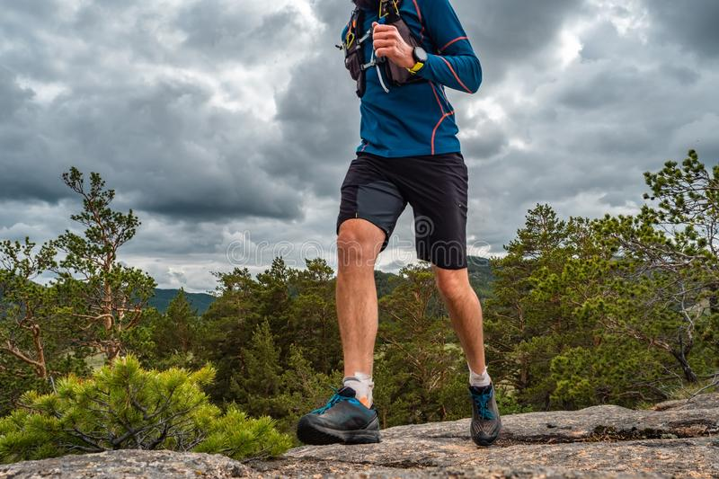 Male runner running on a mountain trail royalty free stock photography