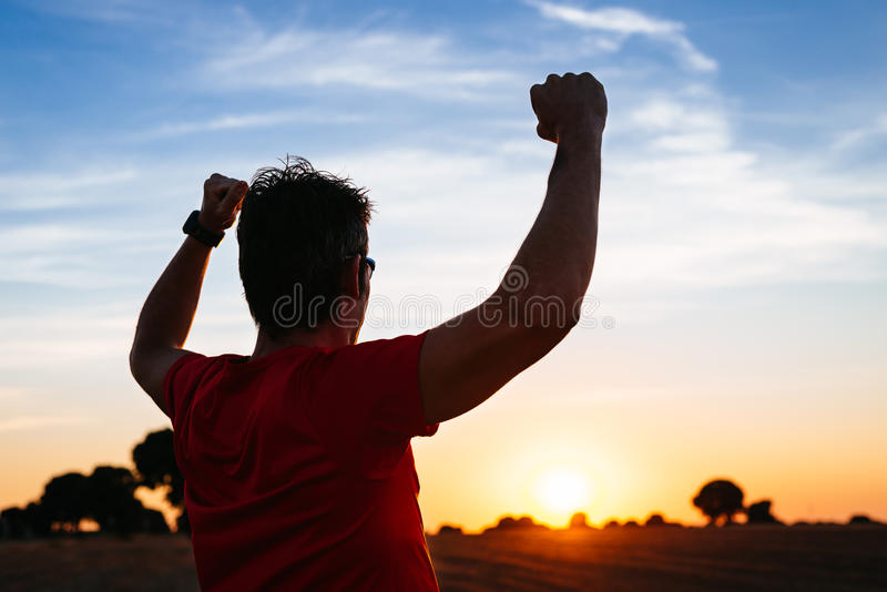 Male runner success at sunset royalty free stock photography