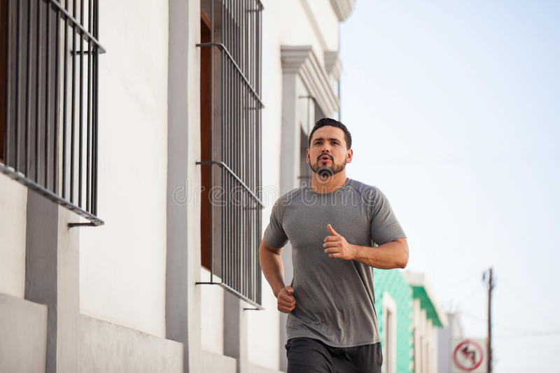 Male runner working out in the city royalty free stock photos