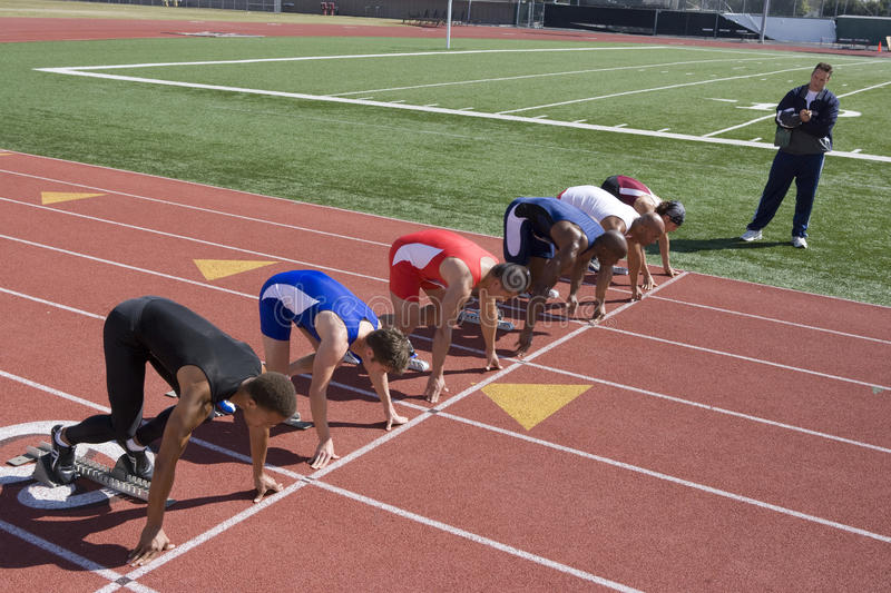 Male Runners Preparing For Race stock photos