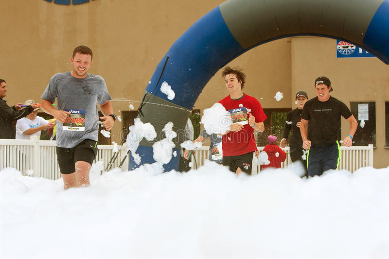 Download Male Runners Run Through Foam At Finish Line Of Race Editorial Photo - Image: 33306406