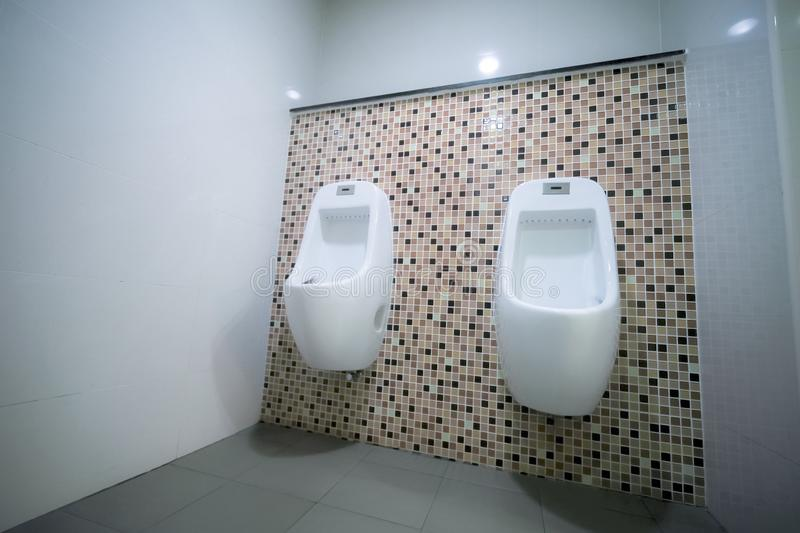Male sanitary ware. White male sanitary ware in public toilets royalty free stock images