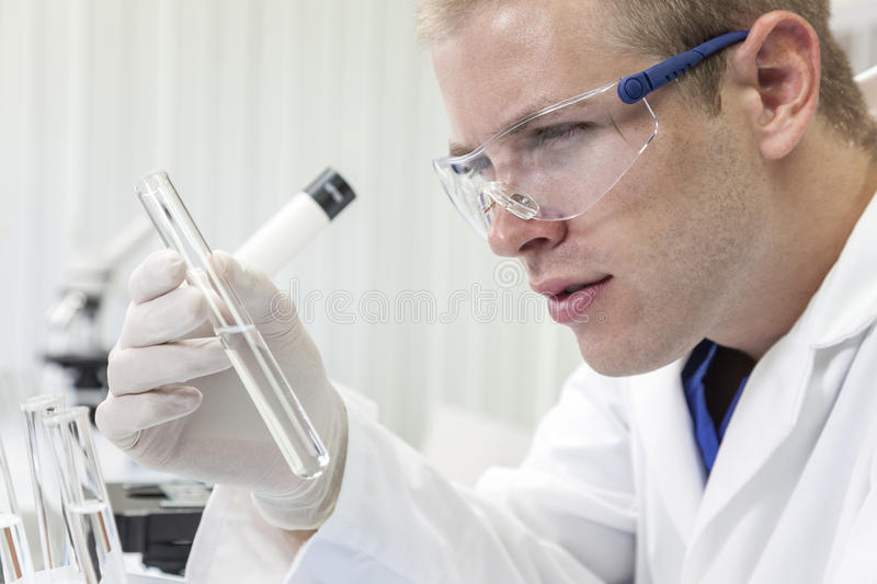 Male Scientist or Doctor With Test Tube In Laboratory stock photography