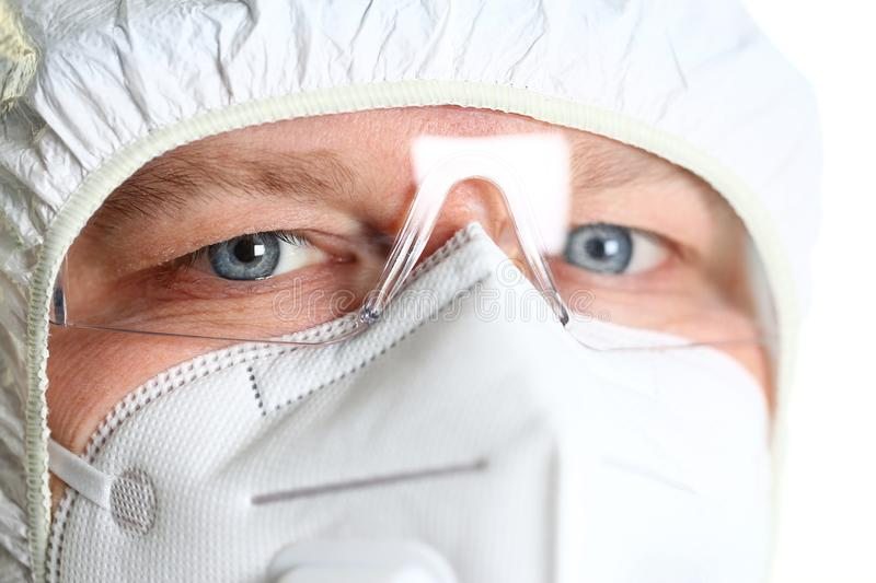 Male scientist wearing white protective suit and mask royalty free stock images