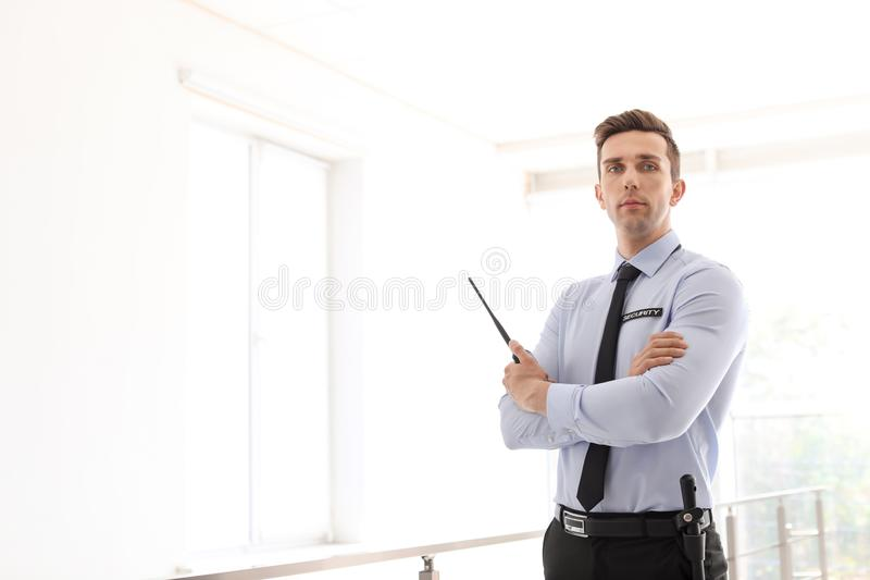 Male security guard with portable radio transmitter royalty free stock photography