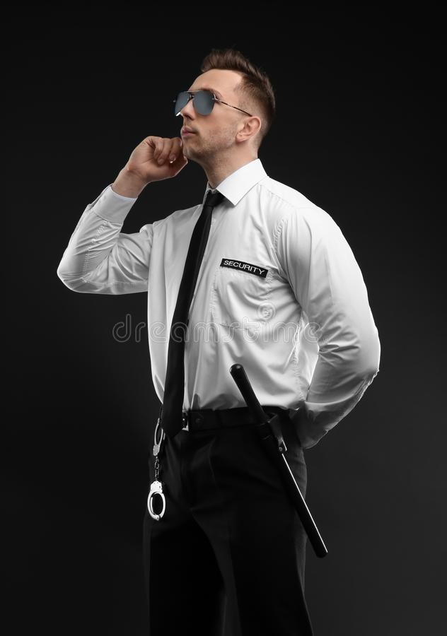 Male security guard in uniform. On dark background stock photo