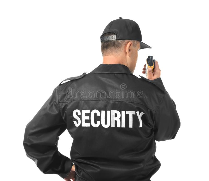 Male security guard using portable radio. On white background stock photos