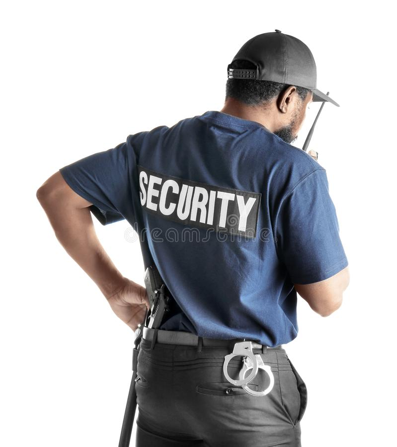 Male security guard using portable radio transmitter. On white background royalty free stock image