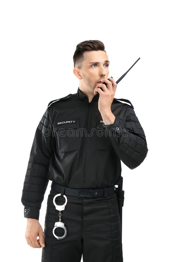 Male security guard using portable radio transmitter stock photography