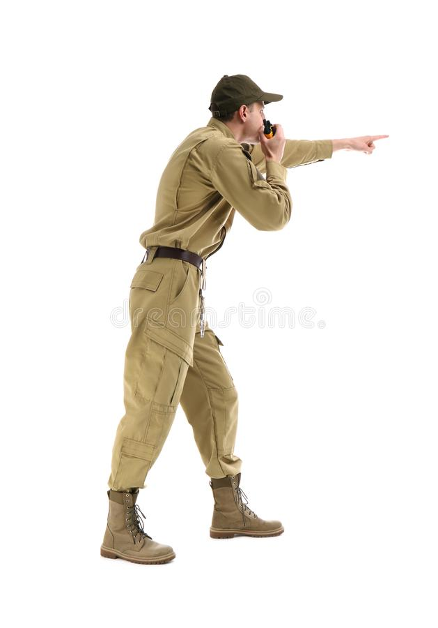 Male security guard using portable radio transmitter. On white background royalty free stock photos