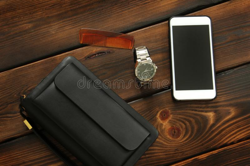 Male set. Men`s Accessories. Bag, watch, phone and hairbrush royalty free stock images