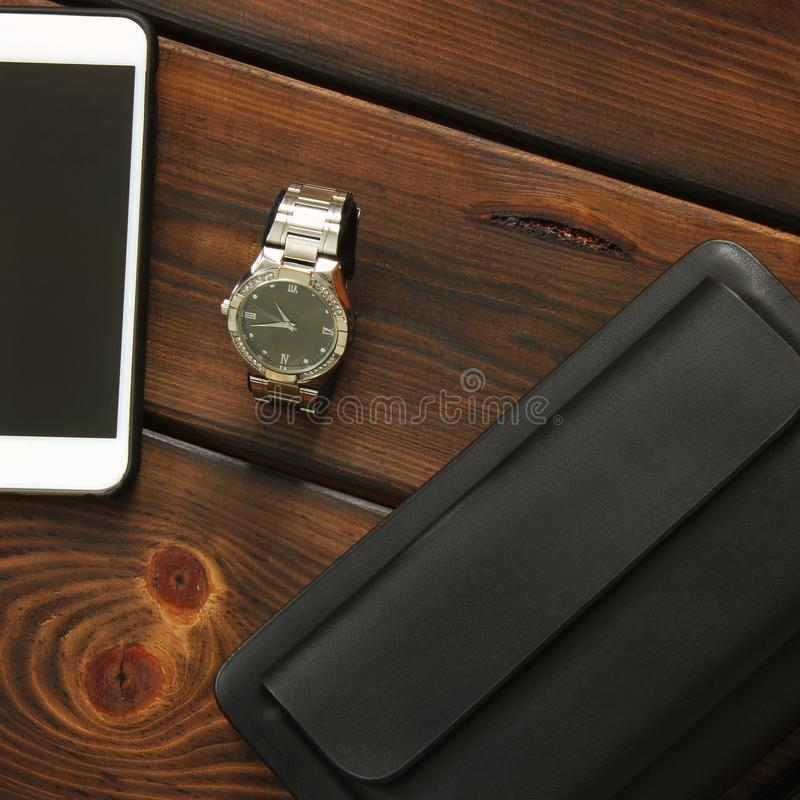 Male set. Men`s Accessories. Bag, watch and phone stock photos