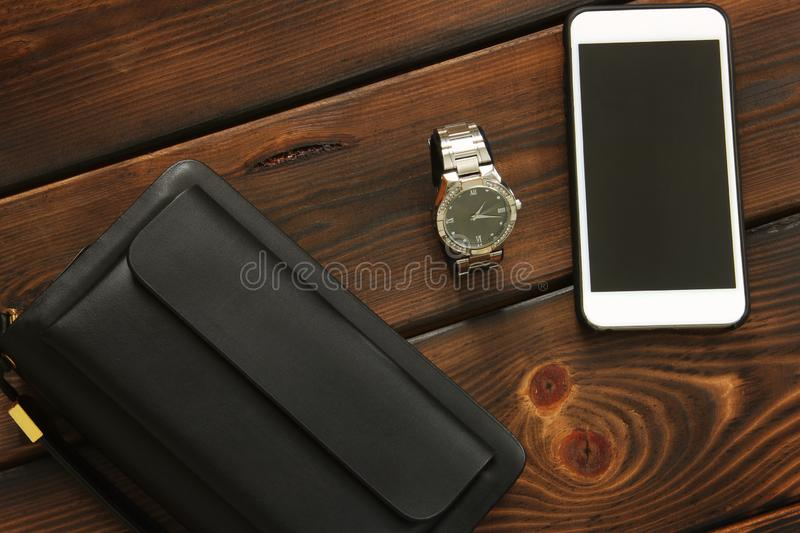 Male set. Men`s Accessories. Bag, watch and phone stock photo