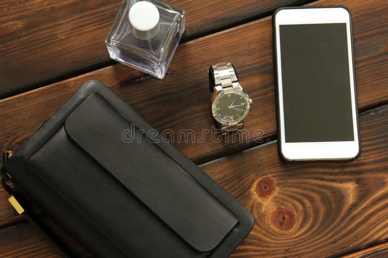 Male set. Men`s Accessories. Bag, Watch, Phone and Perfume royalty free stock image