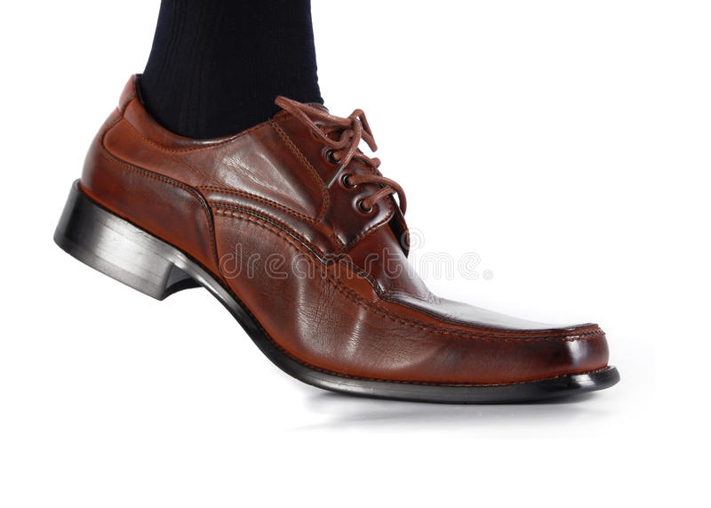 Male shoe in movement stock image
