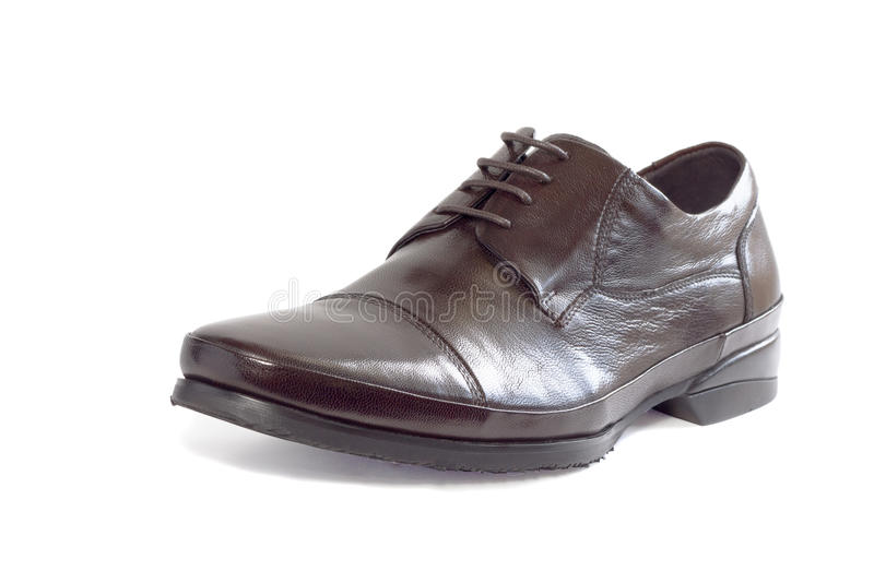 Male shoe on white stock photography