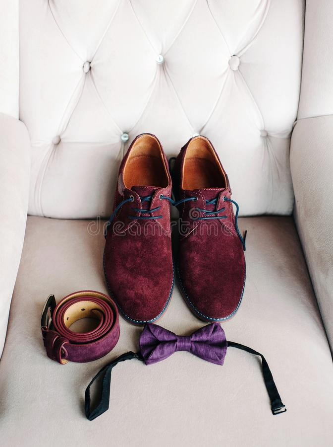 Male shoes, belt and bow tie, wedding groom`s accessories, style and fashion. stock photos