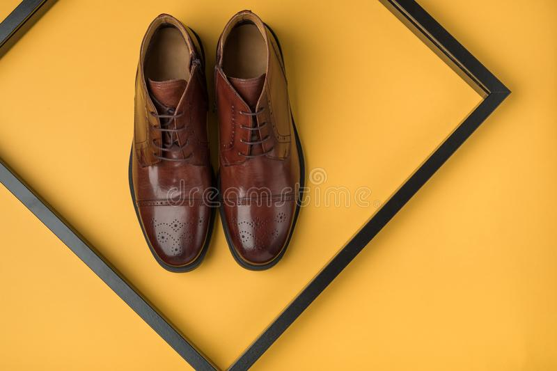 Male shoes. Men`s fashion leather shoes flat lay royalty free stock photos