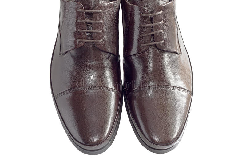 Male shoes on white stock photography