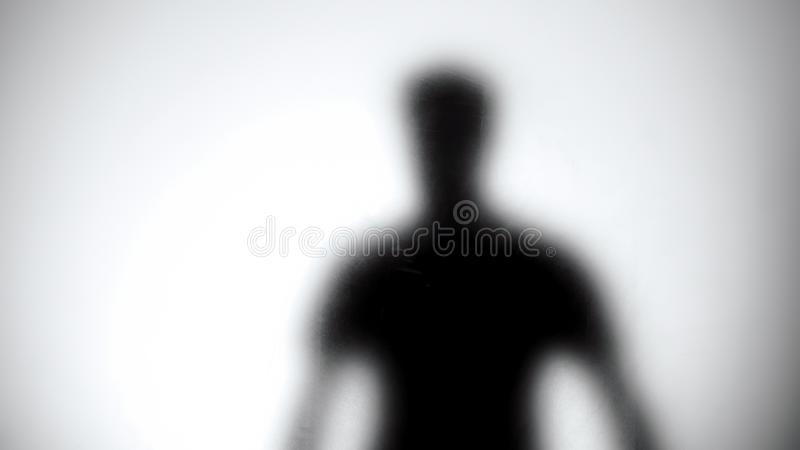 Male silhouette against glass wall, men health statistics template, anonymous royalty free stock photos