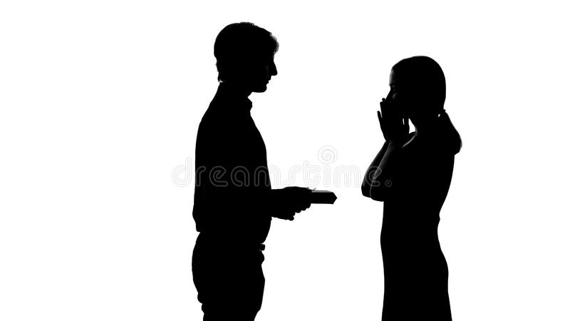 Male silhouette gives present to pretty lady, romantic anniversary of relations. Stock photo stock illustration