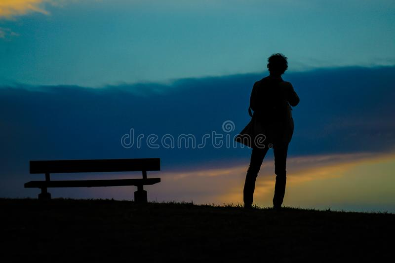 Male silhouette standing in the sunset of the hill. Shooting location :  Chofu, Tokyo royalty free stock photography