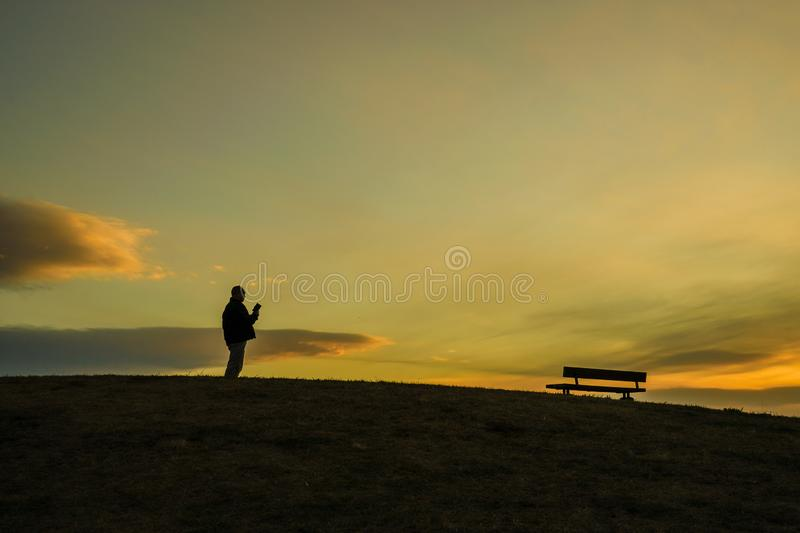 Male silhouette standing in the sunset of the hill. Shooting location :  Chofu, Tokyo stock image