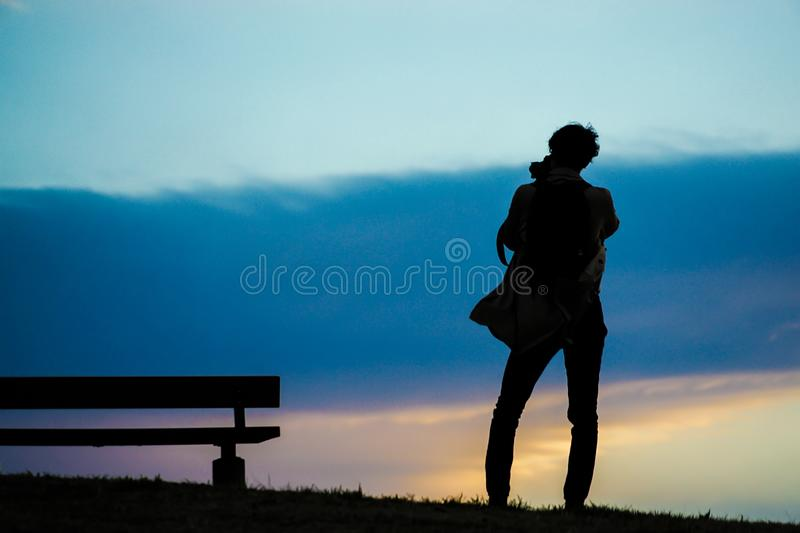 Male silhouette standing in the sunset of the hill. Shooting location :  Chofu, Tokyo stock images