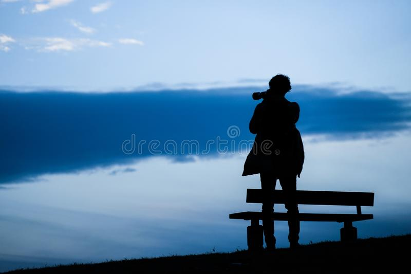 Male silhouette standing in the sunset of the hill. Shooting location :  Chofu, Tokyo royalty free stock photo