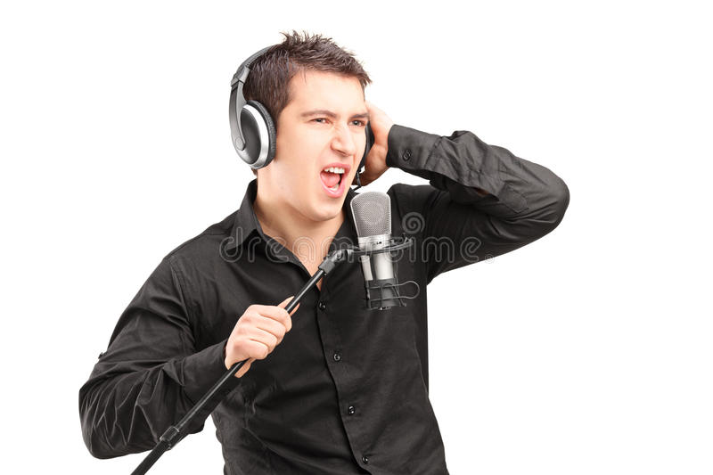 Download A Male Singer With Headphones Performing A Song Stock Photo - Image: 29113202