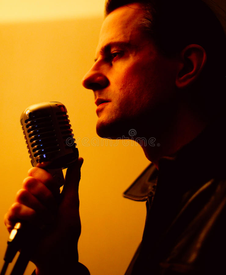 Download Male Singer With Microphone Stock Photo - Image: 14239196