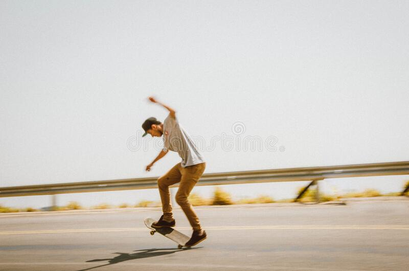 Male skateboarder on road royalty free stock photo