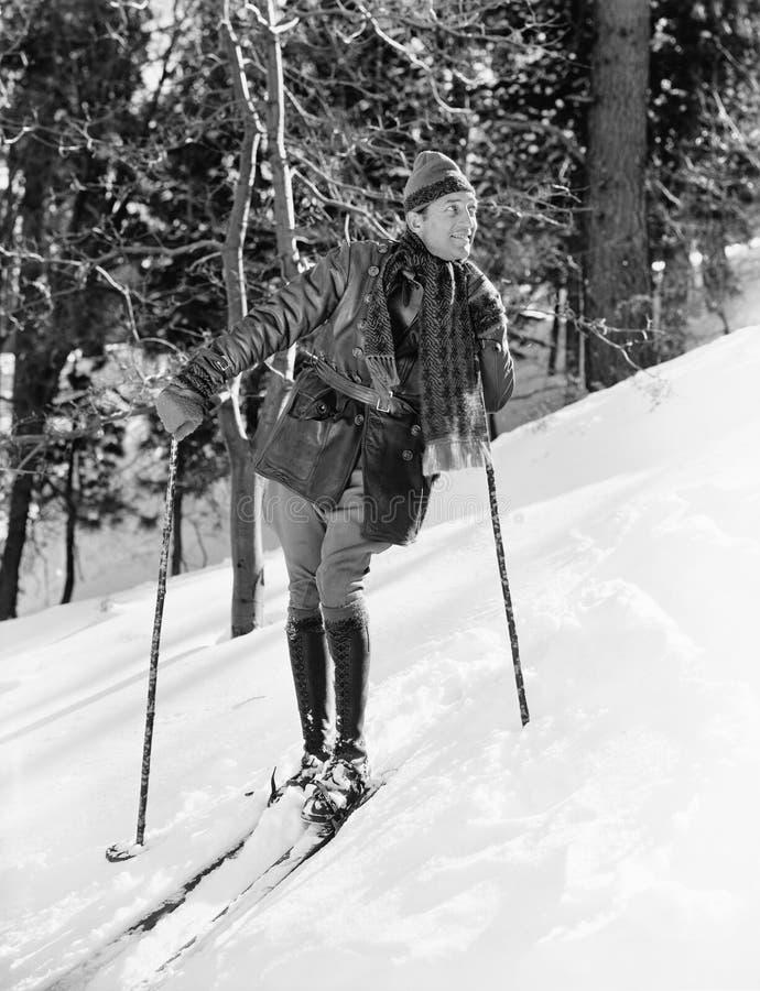 Male skier skiing downhill stock photo