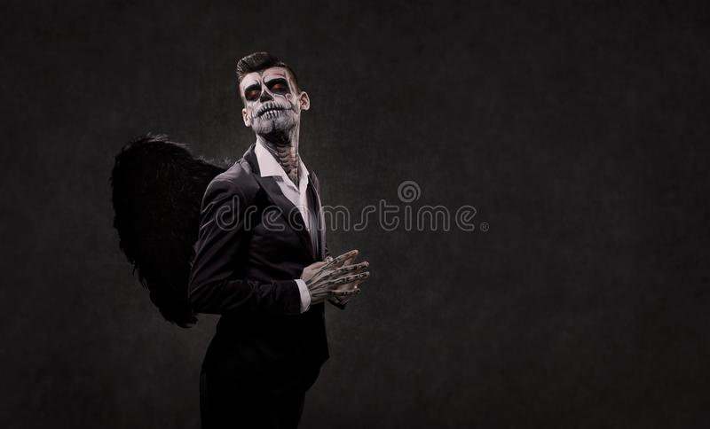 A male skull is an angel with wings. stock images
