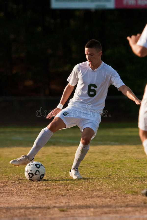 Male Soccer Players Dribbles Ball Royalty Free Stock Photos