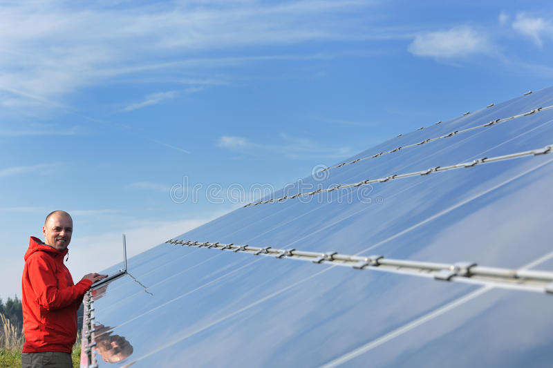Male solar panel engineer at work place stock image