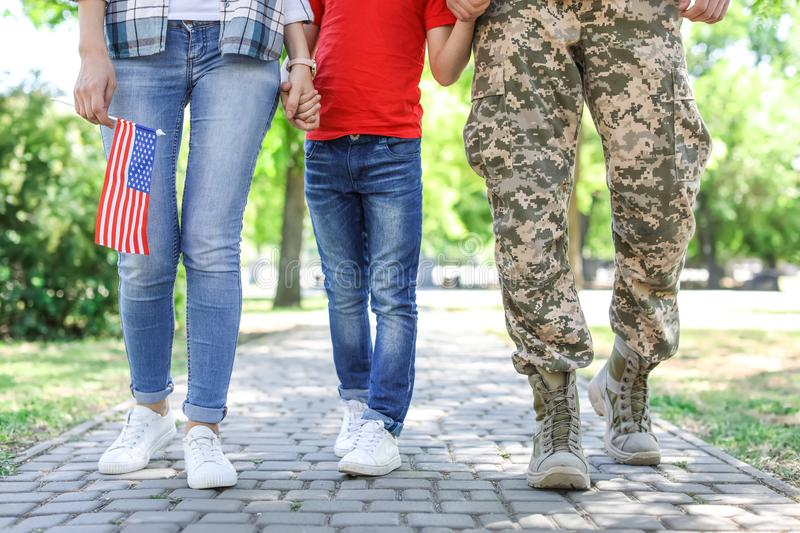 Male soldier with family outdoors. Military service stock photos