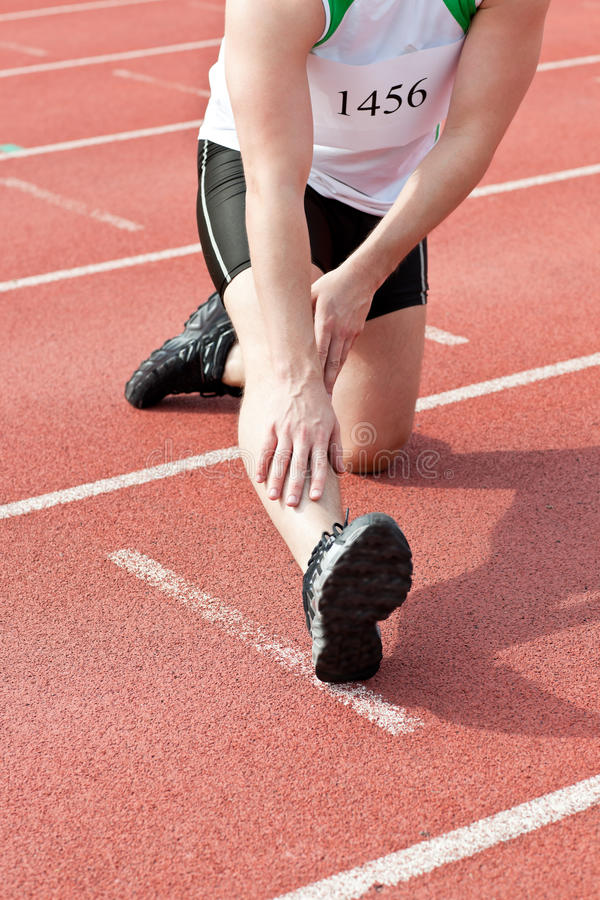 Male Sprinter Warming Up Royalty Free Stock Image