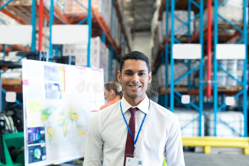 Male staff looking at camera in warehouse. Portrait of happy Caucasian male staff looking at camera in warehouse. This is a freight transportation and stock photos