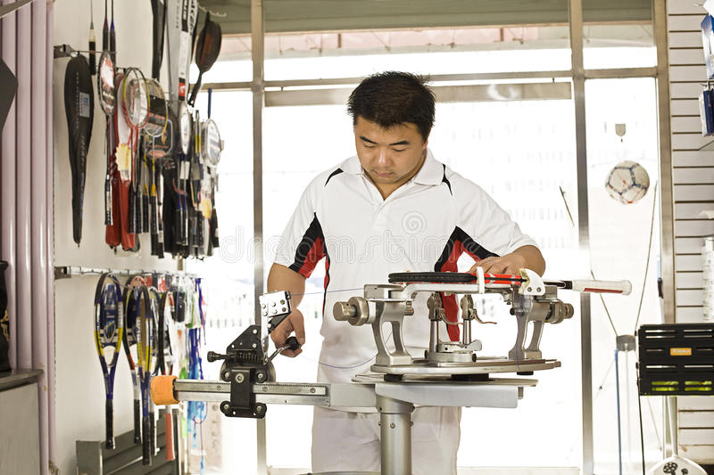 A male staff is working stock images