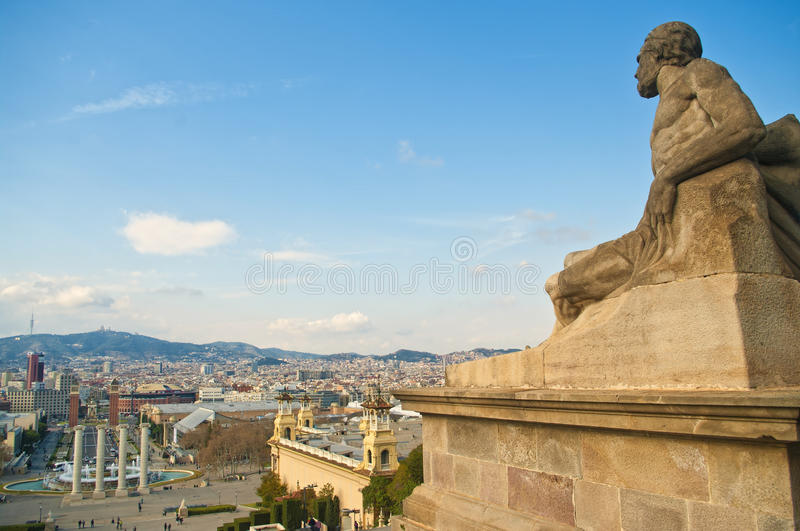 Male statue overlooking city square royalty free stock image