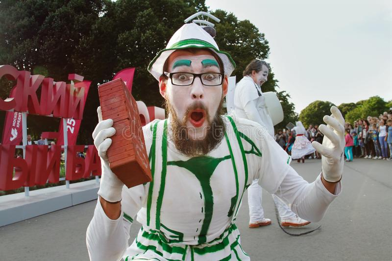 Male street artist with a brick at the festival `Bright people` in the park Gorkogo at the City Day in Moscow Theater `Chaos` royalty free stock image