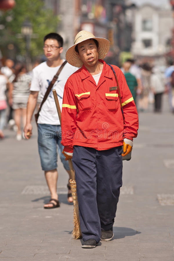 Male street sweeper, Beijing, China royalty free stock image