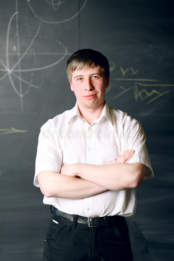 Male student. Standing in classroom royalty free stock photos