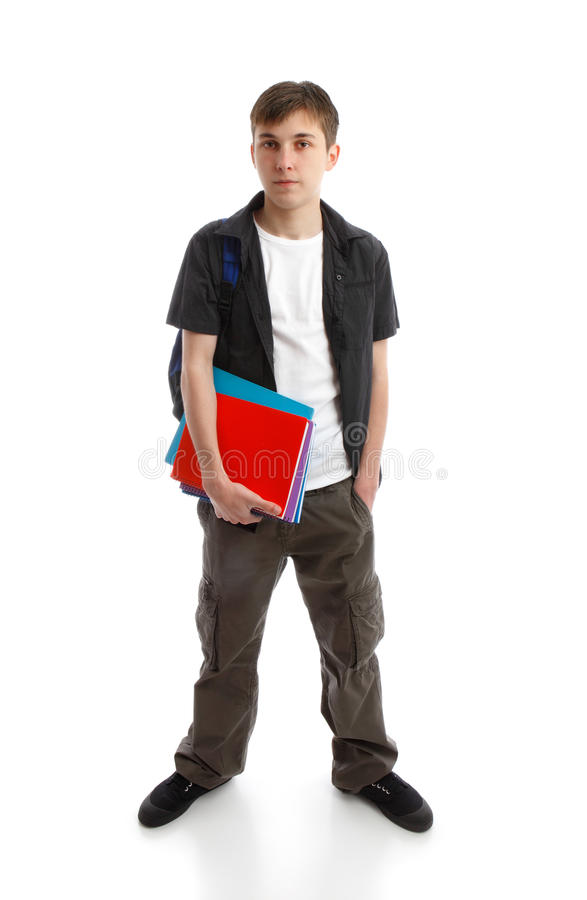 Male Student. A teenage student standing with hand in pocket. He is carrying a backpack and some books. White background stock images