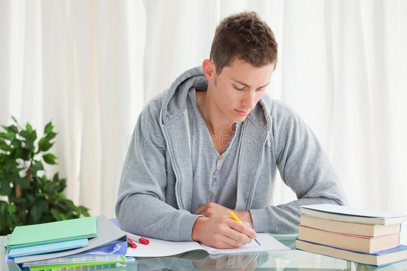 Male student doing his homework royalty free stock photography