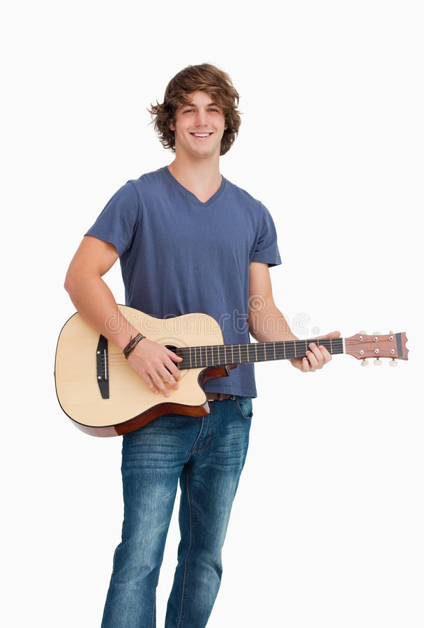 Download Male Student Posing While Holding A Guitar Stock Photo - Image: 25335252