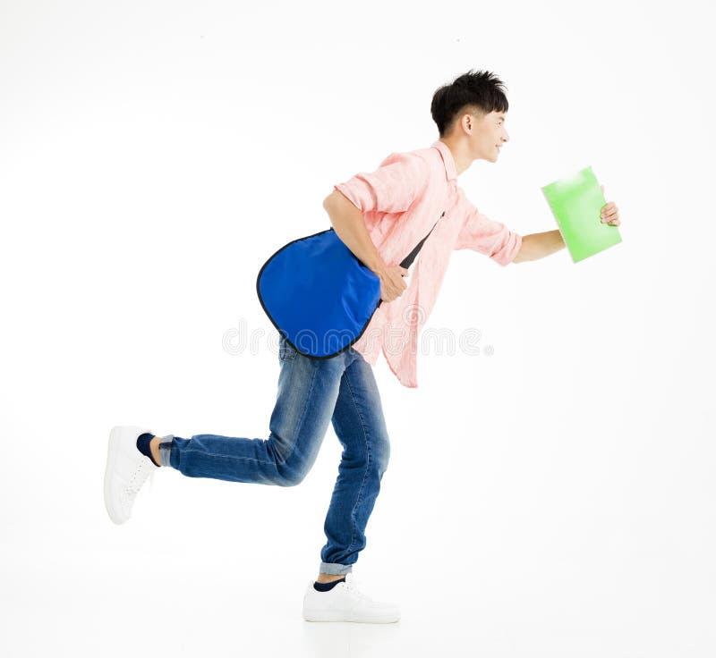 male student in rush running stock image