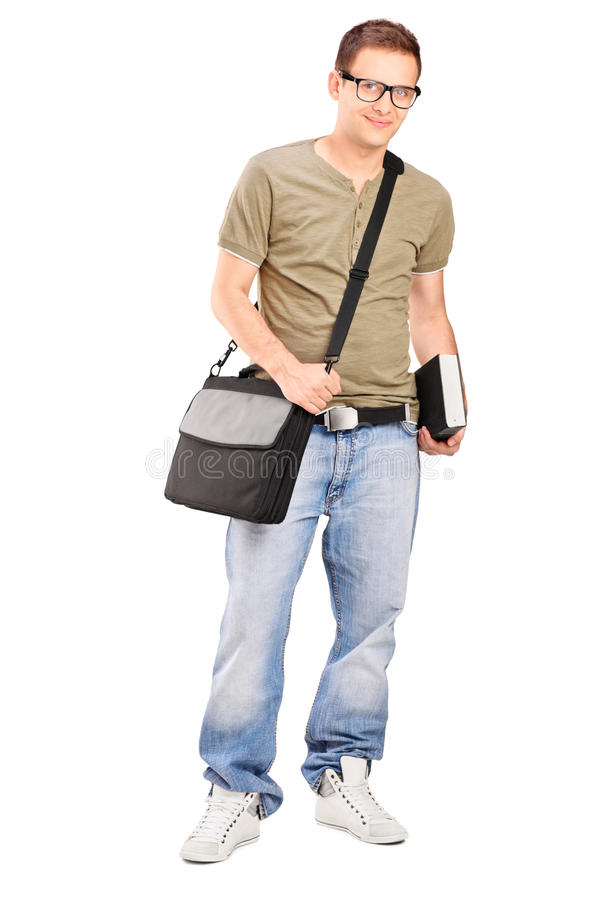 Download Male Student With Shoulder Bag Holding A Book Stock Images - Image: 28268244